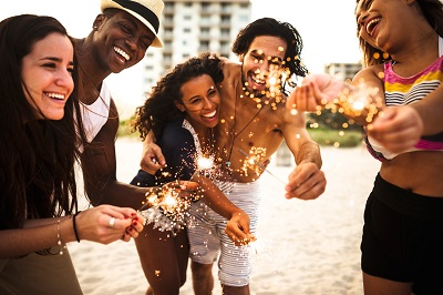 friends on beach with sparklers