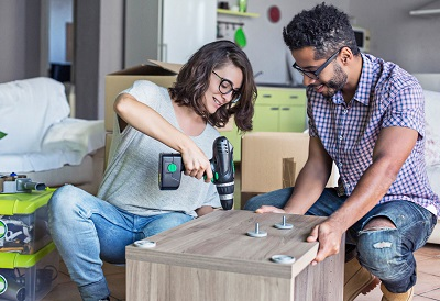 couple putting together furniture