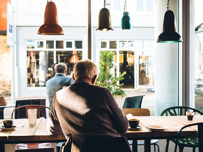 man at cafe; photo by Jeff Sheldon on Unsplash