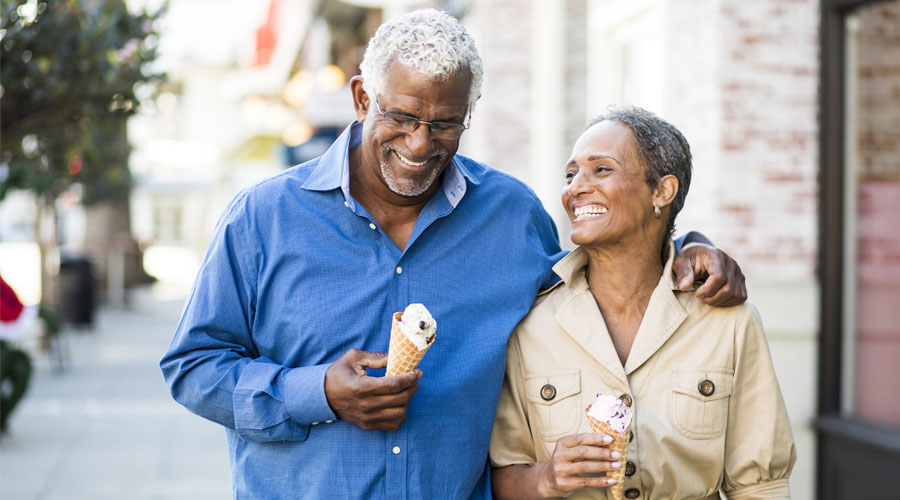 A senior African American couple enjoy an evening on the town with ice cream