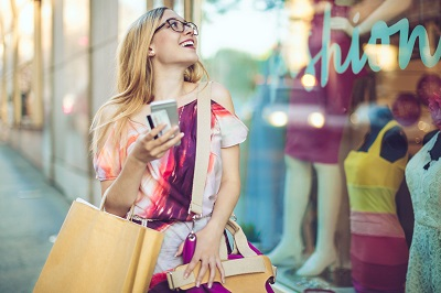 woman window shopping with credit cards