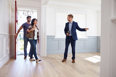couple house hunting with real estate agent