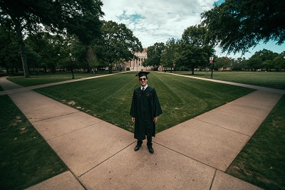 college graduate on campus; photo by Jonathan Daniels on Unsplash